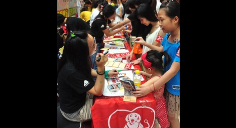 Animals Asia's booth interests a huge number of visitors.