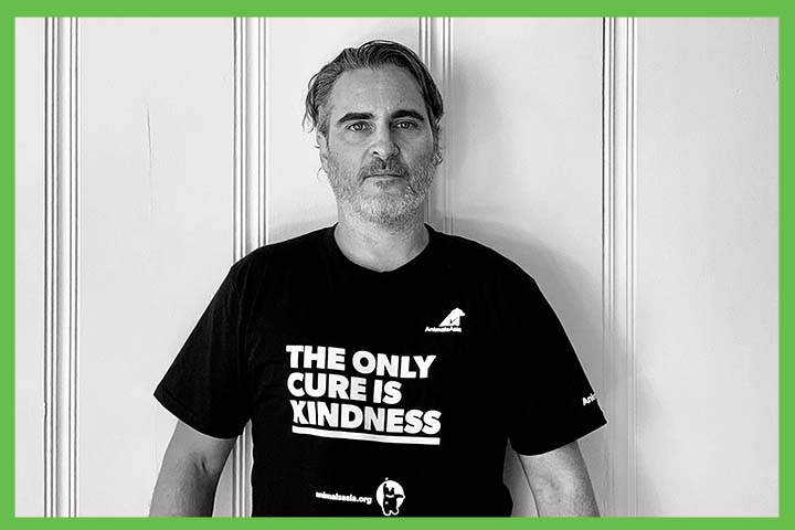 "Joaquin Phoenix wearing a t-shirt bearing the words ""The Only Cure is Kindness"""